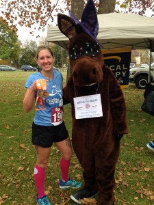 Tracy with Della the Mule proudly showing her medal and one dedicated to Keegan.