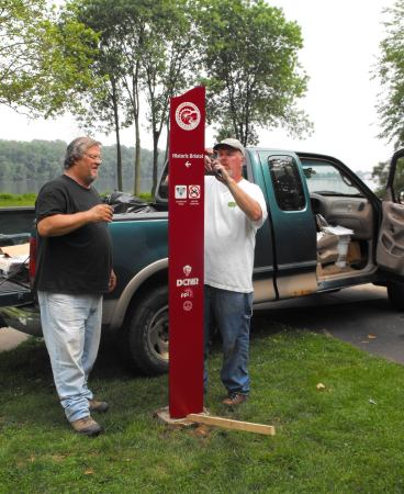 Rollie Rhodomoyer and Scott Everett of the D&L install a blade