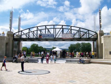 Visitors stroll through the River Common entrance, which will double as a flood gate during periods of high water.