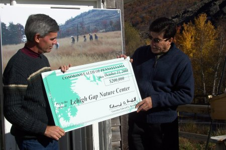 Secretary DiBerardinis presents the LGNC's Dan Kunkle with a check to continue the Center's work