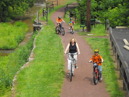 Suzanne Foster leads young bikers down the towpath.