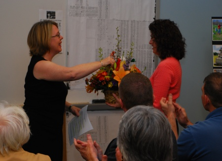 Amey Senape receives flowers and applause for organizing this successful event. (Courtesy of Dana Grubb)